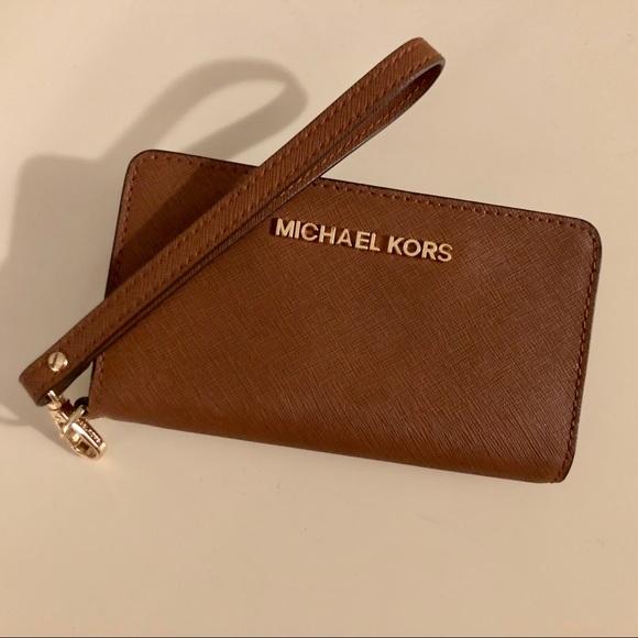 f7c32b40dd Michael Kors Saffiano Leather Wristlet Phone Case.  M_5b0e1bcc05f430c3be00fa2b